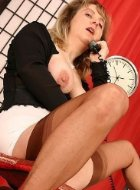 Horny mature in stockings playing with her pussy