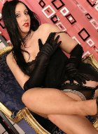 Brunette mature in stockings demonstrates legs