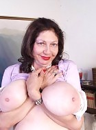 old granny showing off her huge tits