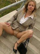 Hottest mature in pantyhose showing legs outdoor