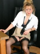 Mature teacher in stockings strips and shows legs