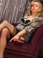 Horny mature in stockings demonstrates her legs