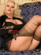 Alluring mature poses and takes off stockings