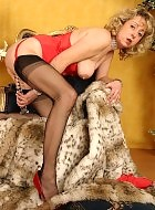 Horny mature in stockings and red corset posing