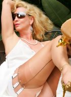 Blonde mature in nylon shows her legs outdoor