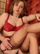 Horny mature in stockings and red lingerie posing