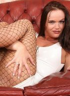 Brunette mature in fishnet pantyhose shows legs