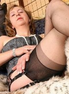 Hottest mature in stockings demonstrates legs
