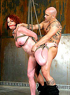 Redhead slave MILF Kylie Ireland getting rough all holes fucked
