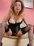 Hottest mature in nylon and black corset posing
